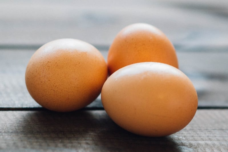 Three eggs with shell on table